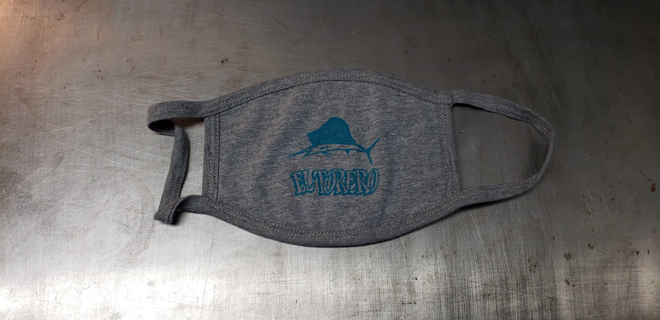 Heather grey cotton face mask with union screen printed one color design for EL TORERO restaurant with a swordfish above the restaurant name